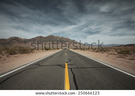panoramic view of hot summer road through the Mojave desert, california - stock photo