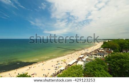 Panoramic view of Kolobrzeg beach, blue sky, Poland - stock photo