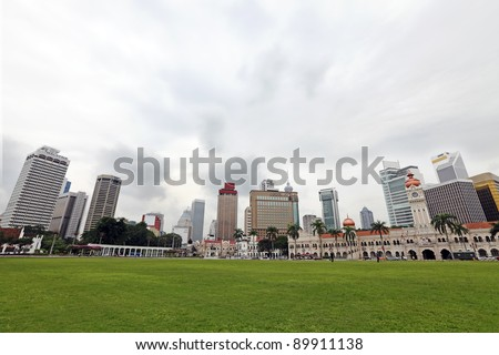 Panoramic view of Kuala Lumpur city skyline from the historic Merdeka Square against a sky with the cloud in motion. - stock photo