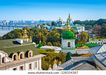 Panoramic view of Kyiv-Pechersk Lavra churches, the Dnieper river and high buildings in Kyiv, Ukraine  - stock photo