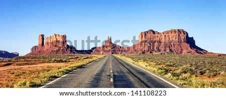 panoramic view of long road at Monument Valley, USA - stock photo