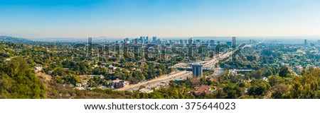 Panoramic view of Los Angeles with busy freeway - stock photo