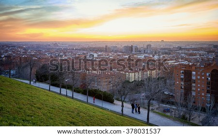 """Panoramic view of Madrid, Spain. Photo taken from the hills of """"Tio Pio Park"""", """"Vallecas"""". Sunset. - stock photo"""