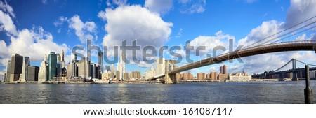 Panoramic view of Manhattan skyline and Brooklyn Bridge, New York - stock photo
