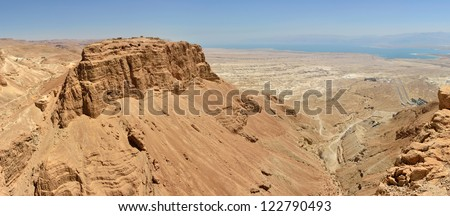 Panoramic view of Masada summit and Dead Sea in Judea desert, Israel. - stock photo