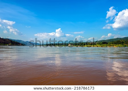 Panoramic view of Mekong river flowing between Laos on right side and Thailand at left side. Travel landscape and destinations - stock photo
