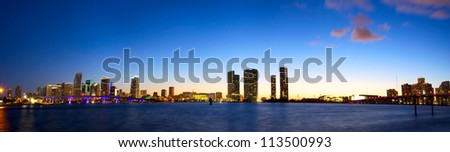 Panoramic view of Miami skyline and Biscayne Bay at dusk - stock photo