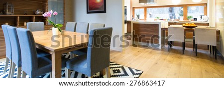 Panoramic view of modern kitchen connected with dining space  - stock photo