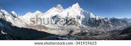 panoramic view of Mount Everest with beautiful sky and Khumbu Glacier - way to Everest base camp, Khumbu valley, Sagarmatha national park, Nepal  - stock photo