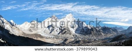 panoramic view of Mount Everest with beautiful sky and Khumbu Glacier - way to Everest base camp, Khumbu valley, Sagarmatha national park, Nepal  - stock photo