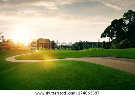 panoramic view of nice green hill on blue sky background - stock photo