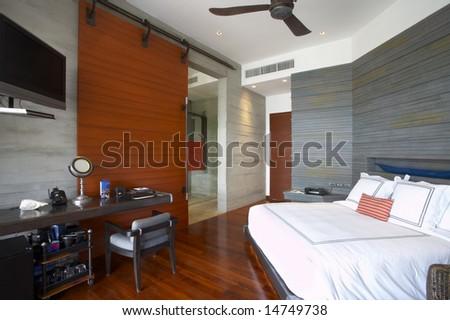Panoramic view of nice  light stylish  hotel room. - stock photo