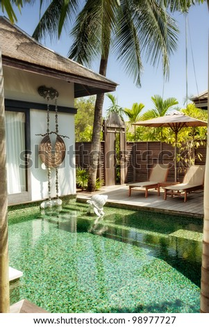 panoramic view of nice tropical villa with pool - stock photo
