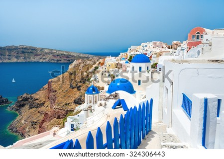 Panoramic view of Oia town, Santorini island, Greece. Beautiful landscape with sea view. - stock photo