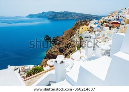 Panoramic view of Oia town, Santorini island, Greece. Beautiful landscape with sea view. - stock photo
