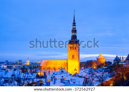 Panoramic view of old part of Tallinn in winter. Niguliste church at night - stock photo