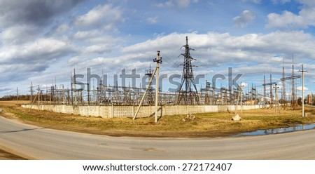 panoramic view of old power plant  and electricity pylons  - stock photo