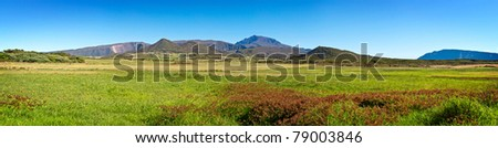 Panoramic view of Plaine des Cafres plateau with Piton des Neiges massif in background, Reunion Island - stock photo