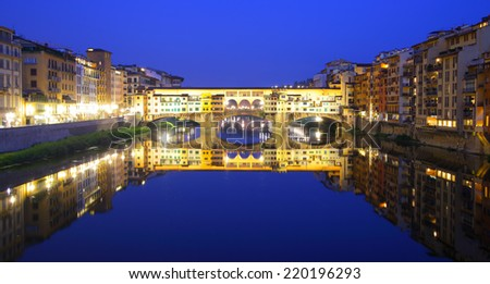 Panoramic view of Ponte Vecchio bridge in Florence at night, Italy - stock photo