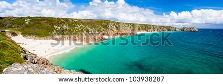 Panoramic view of Porthcurno Beach and Treen Cliffs from the coastpath near the Minack Cornwall England UK - stock photo