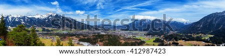 Panoramic view of Reutte with Alps and clouds, high resolution image. Alps, Tyrol, Austria. - stock photo