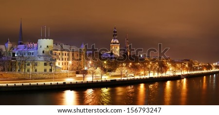 Panoramic view of Riga presidential palace by night - stock photo
