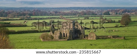 Panoramic view of ruins of an Hore Abbey in Cashel, Ireland. It is a ruined Cistercian monastery and famous landmark in Tipperary - stock photo