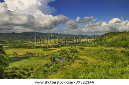 Panoramic view of rural landscape with tropical vegetation on cuban countryside - sierra del escambray, trinidad - stock photo