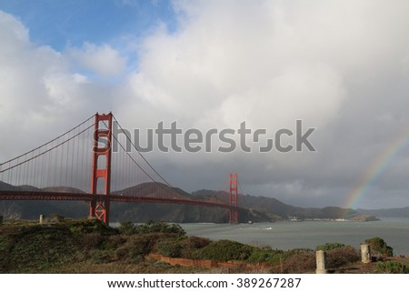 Panoramic view of San Francisco Bay and Golden Gate Bridge with Rainbow on the Sky - stock photo