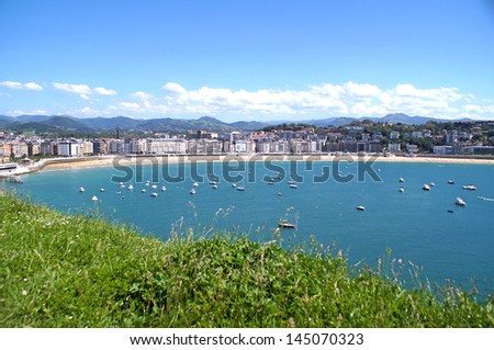 Panoramic view of San Sebastian and the colorful sea on a sunny day - stock photo