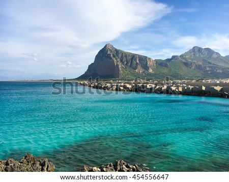 Panoramic view of San Vito lo Capo and Monte Monaco in background, north-western Sicily. This famous beach has been elected best italian beach on TripAdvisor. - stock photo