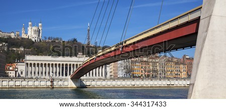 Panoramic view of Saone river at Lyon with red footbridge, France - stock photo