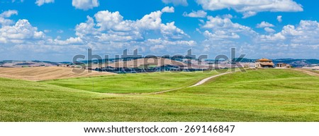 Panoramic view of scenic Tuscany landscape with rolling hills and traditional farm house in Val d'Orcia, Italy - stock photo