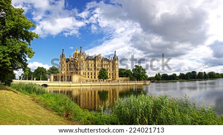 Panoramic view of Schwerin Castle (Schweriner Schloss) reflected in the lake, Mecklenburg-Vorpommern state, Germany - stock photo