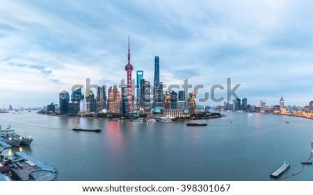 panoramic view of shanghai skyline and huangpu river in nightfall , China - stock photo