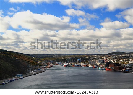 Panoramic view of St. John's Newfoundland, Canada harbor and town in cloudy day.  - stock photo