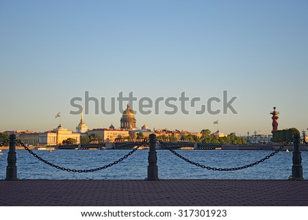 Panoramic view of St. Petersburg with Sachigo Islands, the arrow of Vasilevsky island, Palace bridge and the Winter Palace on the background of the fence chain closeup on a Sunny summer day. - stock photo