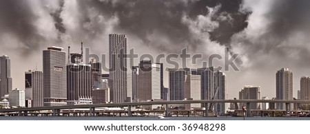 Panoramic view of Storm clouds over Downtown buildings in Miami Florida business and residential district during sunset, with color processing - stock photo
