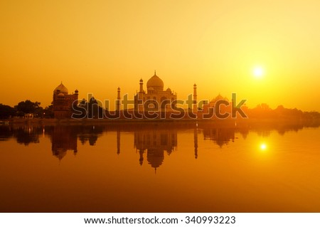 Panoramic view of Taj Mahal at sunset with reflection, Agra, Uttar Pradesh, India. - stock photo