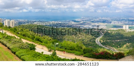 Panoramic view of the bay of Haifa, with downtown Haifa, the harbor, the industrial zone and the slope of Mount Carmel. Viewed from Haifa University. Haifa, Northern Israel - stock photo