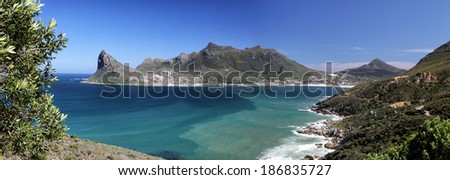 Panoramic view of the bay of Hout Bay, Cape Town, South Africa, seen from Chapmans Peak Drive. - stock photo