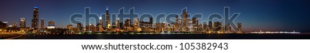 Panoramic view of the Chicago Skyline at Night including the Pier - stock photo