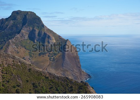 Panoramic view of the coast of volcanic landscape of Robinson Crusoe Island, one of three main islands making up the Juan Fernandez Islands some 400 miles off the coast of Chile - stock photo