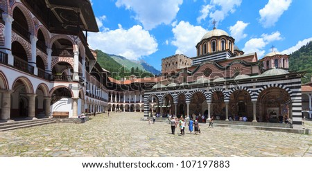 Panoramic view of the courtyard in the famous Rila Monastery, Bulgaria. - stock photo