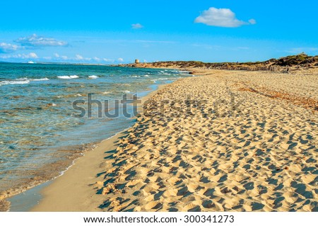panoramic view of the Es Cavallet beach, in Ibiza Island, Spain, and the neighboring Formentera Island in the background - stock photo