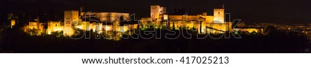 Panoramic view of the famous Alhambra Royal Palace by night from the best viewpoint - Granada, Andalucia, Spain. - stock photo