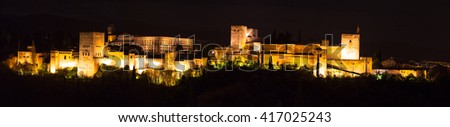 Panoramic view of the famous Alhambra Royal Palace by night from the best viewpoint, Granada, Andalucia, Spain. - stock photo