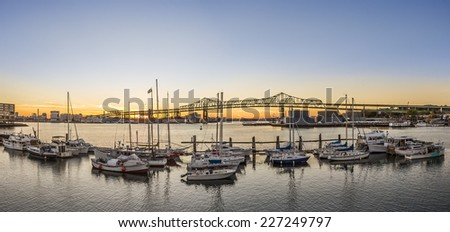 Panoramic view of the Famous Tobin Bridge in Boston, Massachusetts, USA at sunset as seen from Chelsea. - stock photo