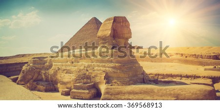 Panoramic view of the full profile of the Great Sphinx with the pyramid in the background in Giza. Egypt. Filtered image:cross processed lomo effect. - stock photo