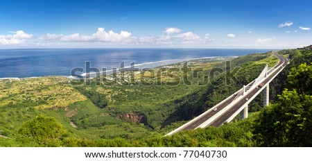 Panoramic view of the Grand Ravine Viaduct, which is a single-span bridge and part of the Route de Tamarins Road Development on Reunion Island - stock photo
